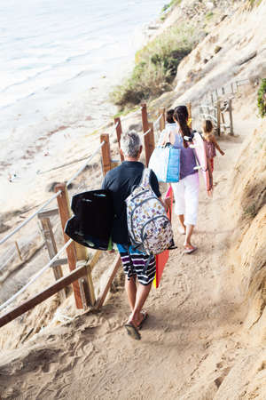 sleeve: Family walking to beach with surfboards,Encinitas,California,USA