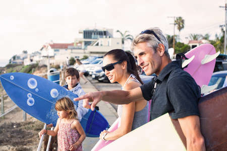 Family at coast with surfboards,Encinitas,California,USA
