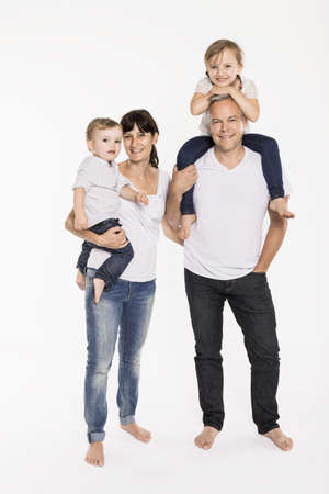 30 years old man: Studio portrait of parents with their young daughter and toddler son