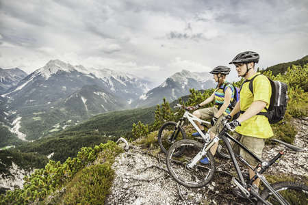 Mountain bikers looking at view of mountains