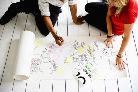 top animated: Graphic designers brainstorming on floor