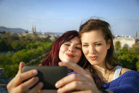 Two young women taking self portrait, Vienna, Austria