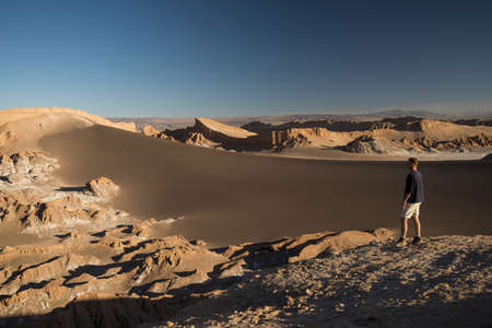 Man enjoying view, Sand Dune (Duna Mayor), Valle de la Luna (Valley of the Moon), Atacama Desert, El Norte Grande, Chile LANG_EVOIMAGES