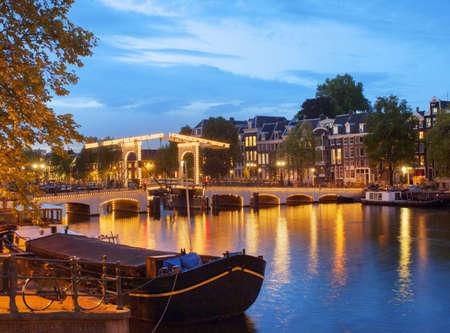 The Skinny Bridge illuminated at dusk, Amsterdam, Netherlands