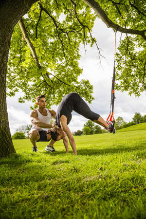 panty hose: Personal trainers doing outdoor training in urban place, Munich, Bavaria, Germany