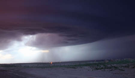 environmental issues: This mother ship looking storm is in the process of splitting, Burlington, Colorado, USA