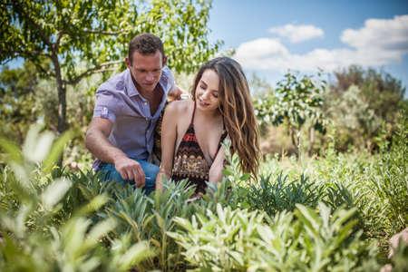 Young couple tending herbs, Castiadas, Sardinia, Italy
