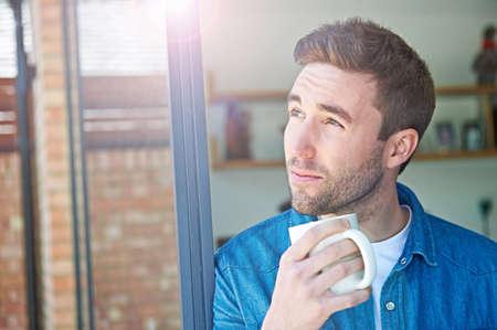 Close up of man with mug LANG_EVOIMAGES