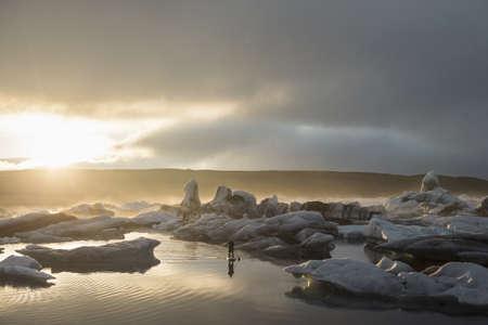 environmental issues: Man on paddleboard, Jokulsarlon Glacier Lagoon, Skaftafell National Park, Iceland LANG_EVOIMAGES