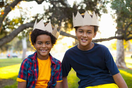 Portrait of two brothers with crowns on heads