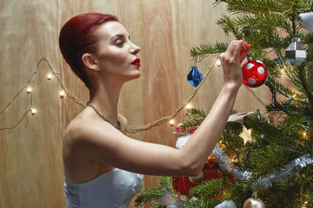 puckered: Woman decorating Christmas tree