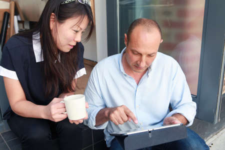 information superhighway: Two architect colleagues using at digital tablet on office step LANG_EVOIMAGES