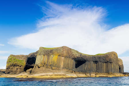 Island of Staffa and entrance to Fingalls Cave, Inner Hebrides, West Coast of Scotland, UK LANG_EVOIMAGES