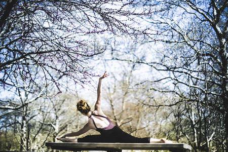 athletic wear:  Modern dancer striking a pose in a urban park