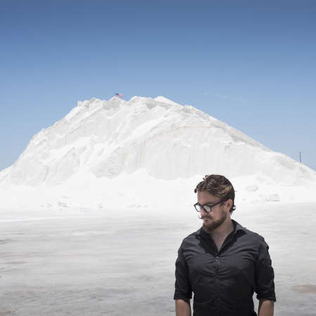 Portrait of man in front of white mountain