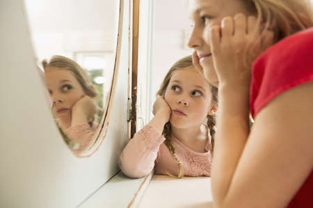 top 7: Sisters staring at each other in bedroom mirror