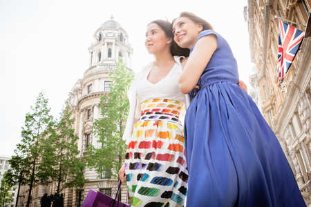 Two young women standing in London street