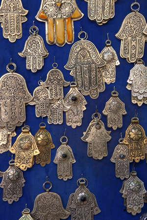 Hand of Fatima amulets on market stall, Marakech, Morocco
