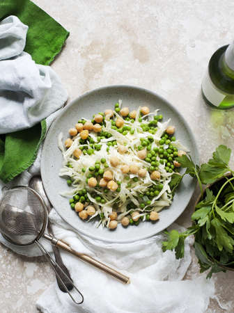 Still life of salad plate with white cabbage and peas