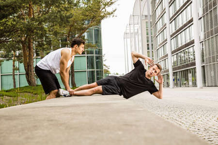 athletic wear: Personal trainers doing outdoor training in urban place, Munich, Bavaria, Germany