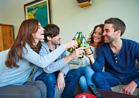 sweatshirts: Group of friends watching sport in living room
