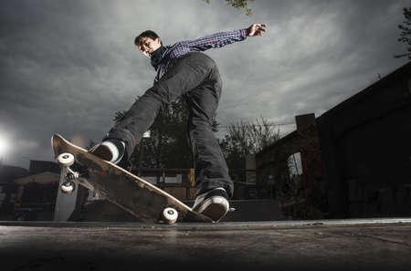 Skateboarding on mini ramp, 5-0 grind to fakie, Berlin, Germany