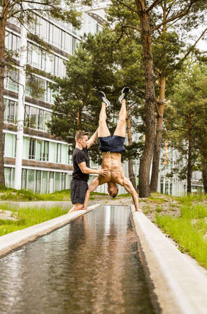 Personal trainers doing outdoor training in urban place, Munich, Bavaria, Germany