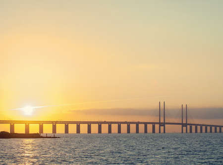 Sunset view of Oresund Bridge between Copenhagen, Denmark and Malmo, Sweden