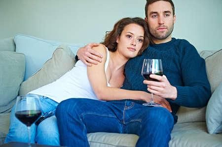 legs around: Couple enjoying wine on sofa