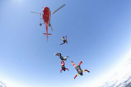 Skydiving team of four free falling from helicopter LANG_EVOIMAGES