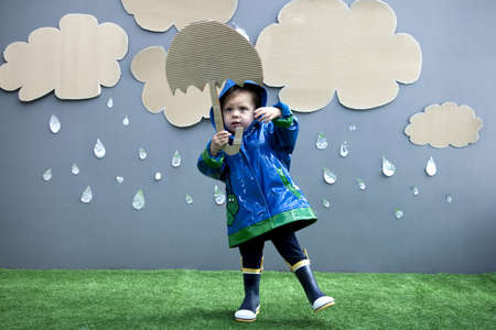 Baby girl with rain and umbrella cutouts