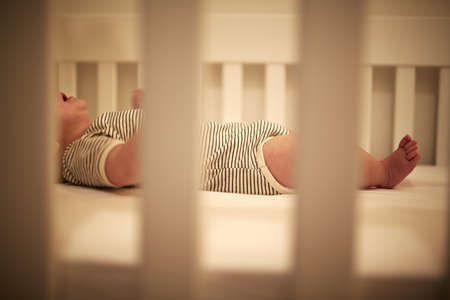Baby boy asleep in crib with mouth open LANG_EVOIMAGES