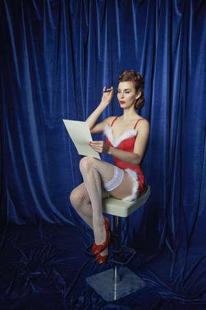 Burlesque woman with Christmas list