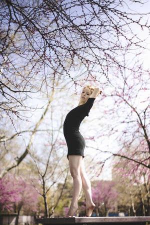 detoxing: Modern dancer striking a pose in a urban park