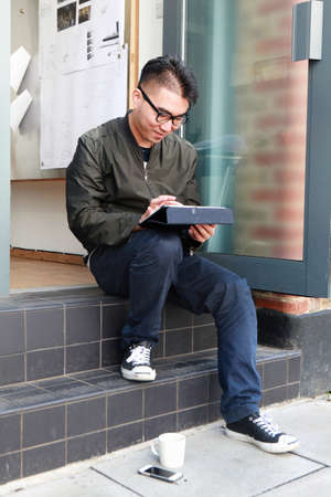 Male architect using digital tablet on office step