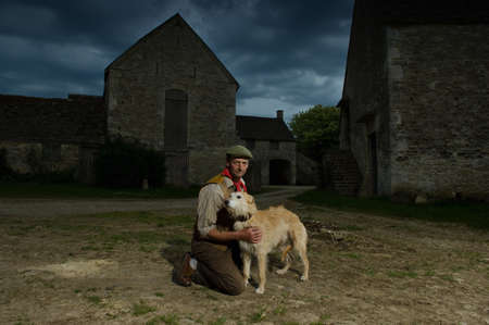 pooches: Portrait of mature traditional farmer and his lurcher dog