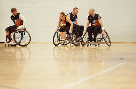 Wheelchair basketball players practising in court