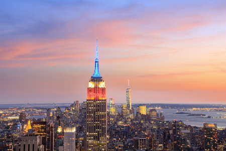 negative area: View of Manhattan skyline and Empire State building at dusk, New York, USA