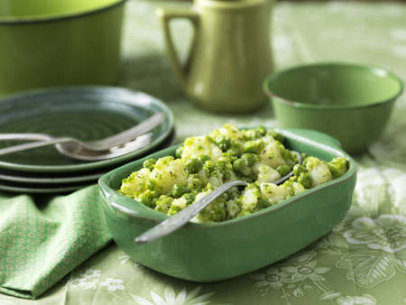 Potatoes and peas salad with minted butter