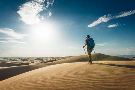 Man hiking in Glamis sand dunes, California, USA