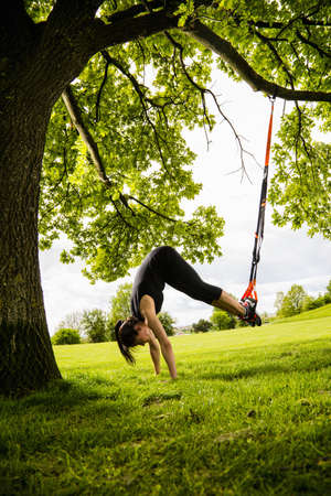 Personal trainer doing outdoor training in urban place, Munich, Bavaria, Germany LANG_EVOIMAGES