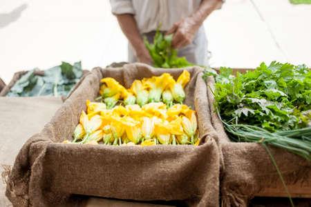 supermarket: Farmer selling organic vegetables on stall