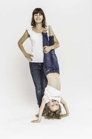 top 7: Mother with daughter doing headstand