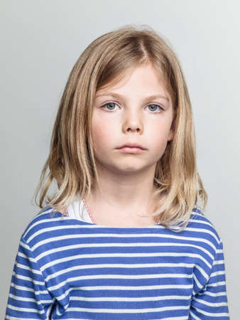 Studio portrait of sullen girl