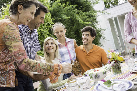 50 54 years: Family enjoying barbecue LANG_EVOIMAGES
