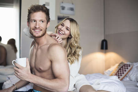 half naked: Young couple fooling around in hotel room
