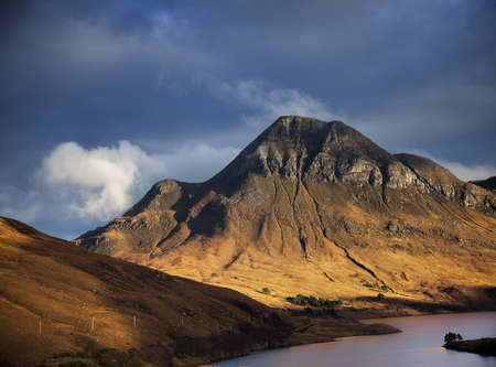 Mountain loch and dramatic sky, Assynt, North West Highlands, Scotland, UK