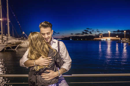 obscuring: Couple hugging by port, Cagliari, Sardinia, Italy