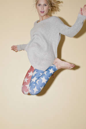sweatshirts: Woman on trampoline, legs tucked under body