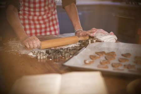 Rolling cinnamon and honey dough to make homemade cookies LANG_EVOIMAGES